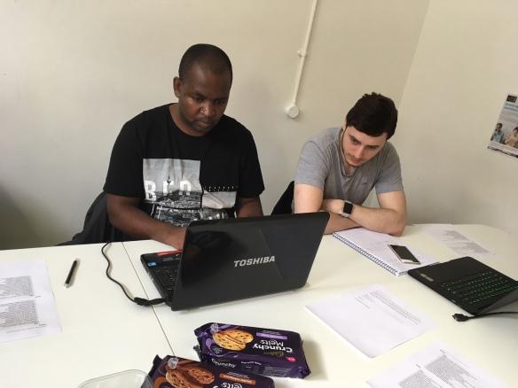 Pedzisai Nemadziba tests the myRAU desktop app while observed by Danny Saggo from ITS