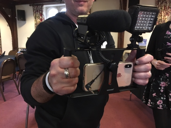 A hand held rig with mic and flash