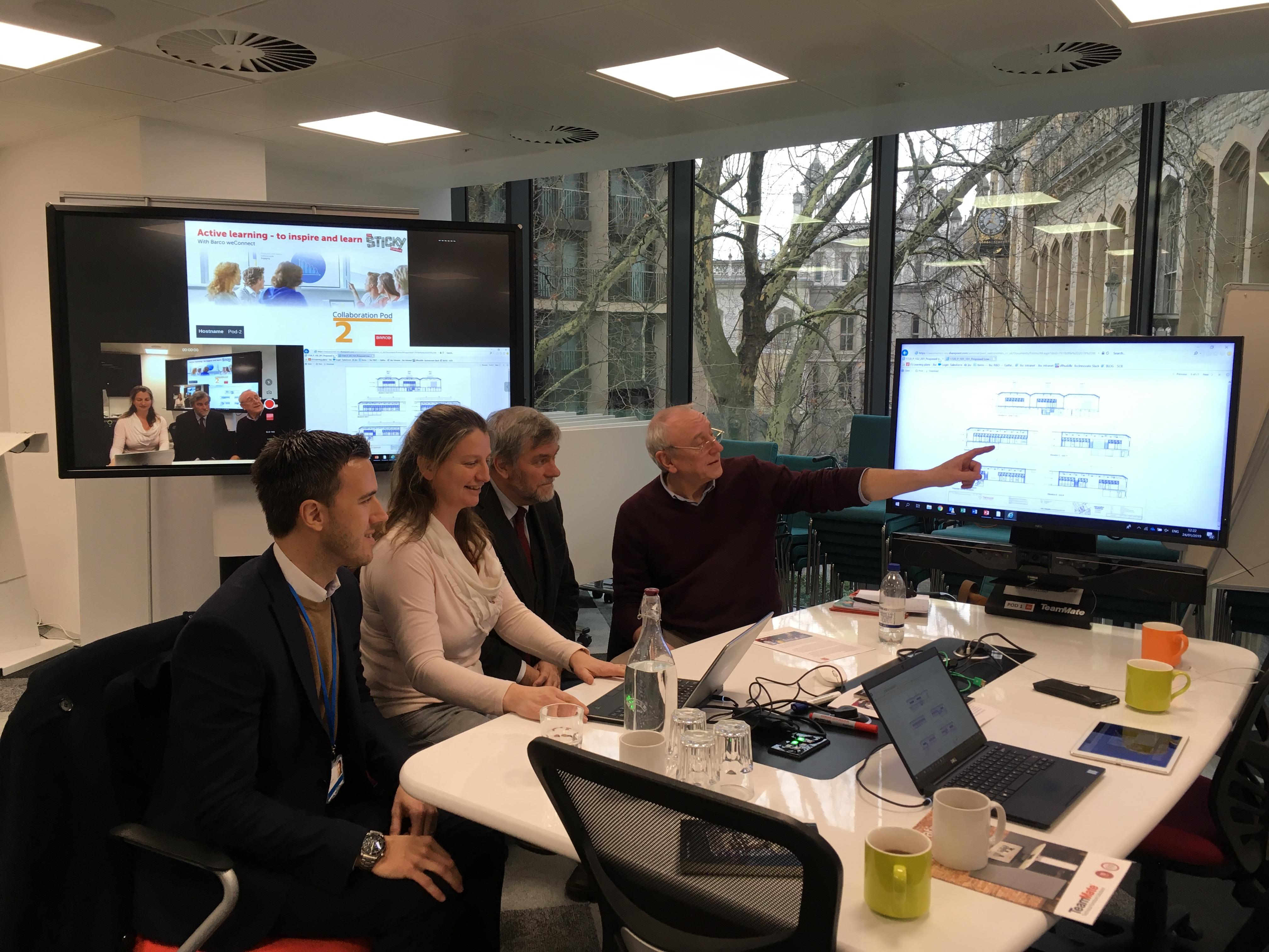 Carl Fry (Jisc), Rachael Foy, Geraint Coles and Alun Dawes (RAU) try out the new digital classroom (Photo courtesy of Anne Stevenson)